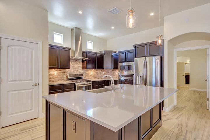 Interview of cullers homes kitchen. Stainless steel appliances and farmhouse sink