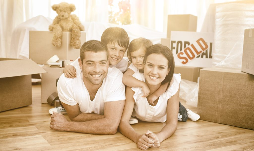 happy family of home buyers in a new home