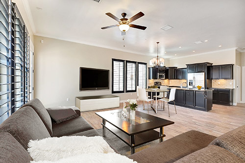 Interior shot of Cullers home showing living room and an open kitchen
